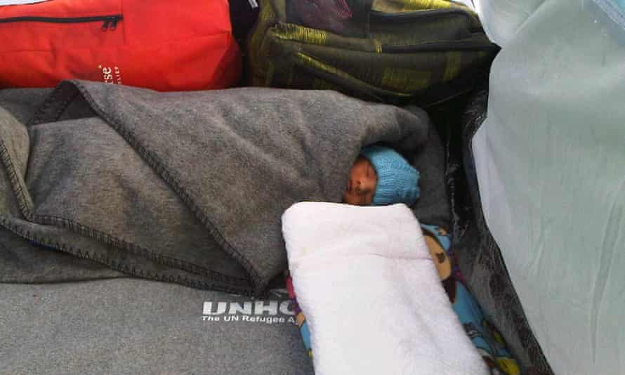 Ten-day-old baby Kasum sleeps in a tent in Idomeni.