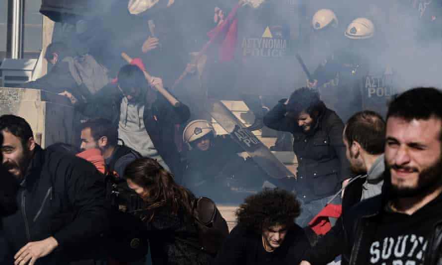 Demonstrators clash with police as they try to enter the parliament building in Athens