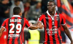 Mario Balotelli  celebrates with his team-mate Dalbert Henrique after putting Nice 3-0 ahead