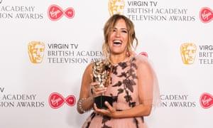 Caroline Flack winning a Bafta award in 2018.
