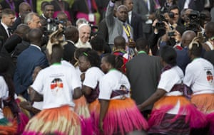 Pope Francis greets traditional dancers.