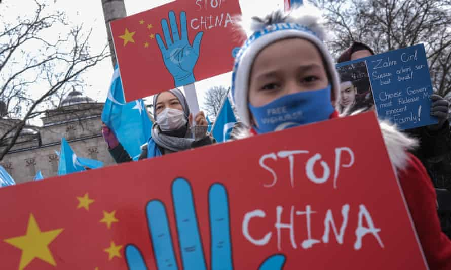 Uyghur protesters who have not heard from their families living in East Turkestan hold placards and flags during a protest last month against China, in Istanbul, Turkey.