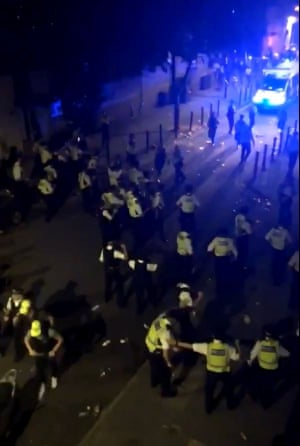 A screengrab from Twitter of the confrontation with police in Brixton last night.