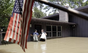 A flooded home in Houston, with tattered US flag