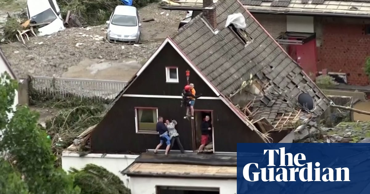 Germany floods: stranded residents rescued by helicopter from rooftops – video