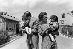 Chirac and his wife, Bernadette, hold children during an official visit to Romania in July 1975