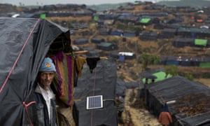 A Rohingya Muslim man stands by the entrance to his tent at Balukhali refugee camp in Cox's Bazar, Bangladesh, on Wednesday. Australia's immigration minister refused to say if Rohingya refugees were being returned to Myanmar.