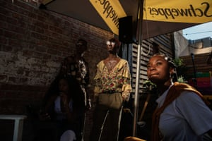 Youngsters who are part of 'The Creatives', a collective of artists based in Pretoria, attend a stand up comedy show