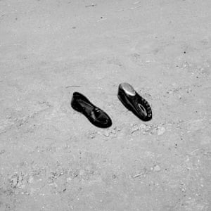 USA. Lamont, California. 2020. Discarded shoes.