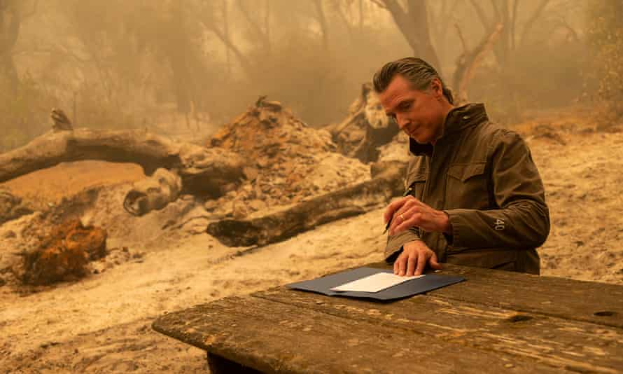 Gavin Newsom signs AB247 after he toured the North Complex fire zone outside Oroville.