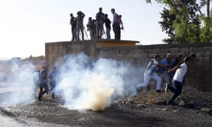 Journalists watch as Kurdish protesters clash with Turkish police and soldiers close to the Turkish-Syria border.
