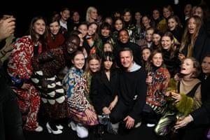 Dries Van Noten and models at his 100th show