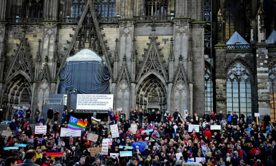 A flashmob gathers in front of Cologne Cathedral to protest against the New Year's Eve attacks.