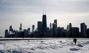 Steam rises from the city buildings and Lake Michigan in Chicago. The weather was caused by a blast of cold air from the North Pole being pushed south into North America.