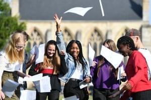 Somto Elumogo (centre) celebrates with fellow pupils at Norwich school in Norfolk