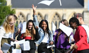 Somto Elumogo (centre) celebrates her GCSE results with friends at Norwich School.