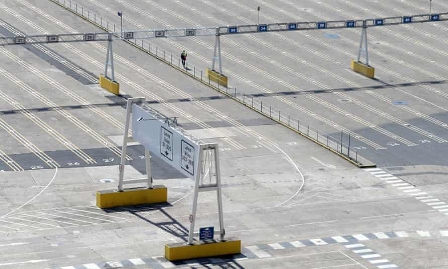 A man walks through the normally bustling but now empty passenger lanes at the busy Port of Dover in Kent, UK.