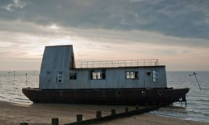 The Medway eco-barge, after it washed up on a beach in Essex.