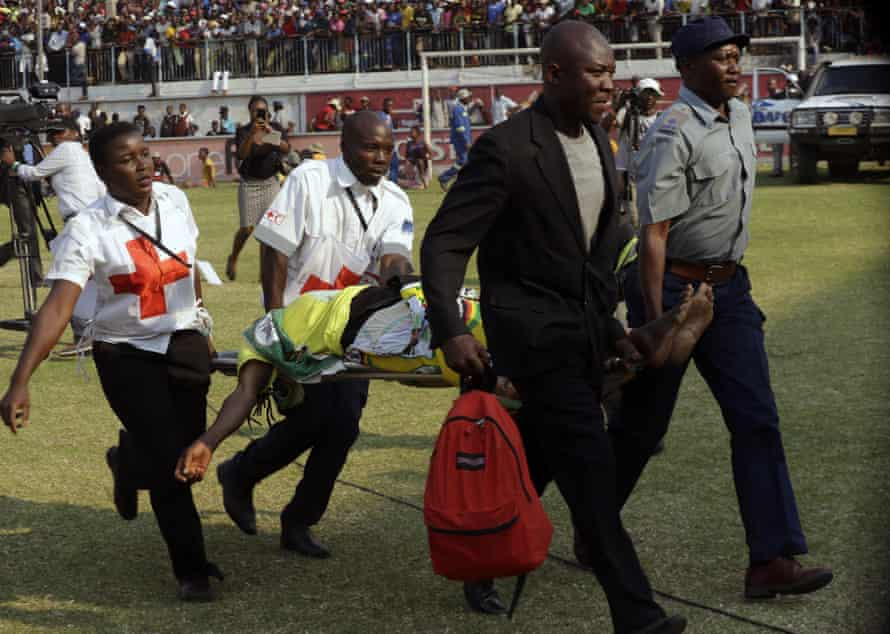 A casualty is rushed off the field after a stampede at the Rufaro stadium in Harare on Thursday.