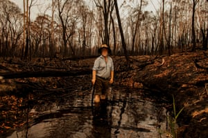"""What drew Conservation Biologist Max James to live in remote Wangarabell 20 years ago was the thought of living a gentle bush life amongst Australia's unique plants, birds and animals. Now living in a fire ravaged landscape Max is keeping close tabs on the recovery of his quiet world. Since the fires and he has taken delight in the small pleasures of witnessing the recovery of the forest and wildlife around him. As a daily ritual he documents the bird species that survived the inferno, makes observations in the surrounding forest and takes in the germinating plant life along three –mile creek, which before the fires was in accessible. """"All has been erased and now nature has to come back through a blank black canvas, it's a lamentable game of survival- but beautiful to watch."""""""
