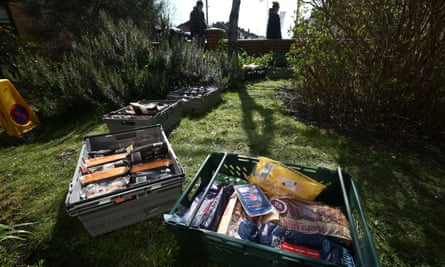 Food packages are left ready for collection by people in need in the front garden of a house in New Malden, south-west London.