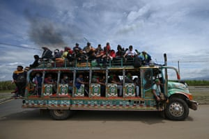 Colombian indigenous people are transported on a chiva, a local bus, during a protest in Cali against the government