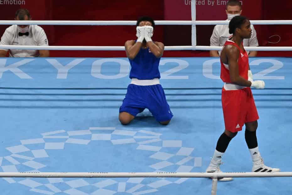 Thailand's Sudaporn Seesondee sinks to her knees after beating Britain's Caroline Dubois in their women's lightweight quarter-final.