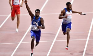 Noah Lyles of the United States crosses the finish line to win ahead of Nethaneel Mitchell-Blake of Great Britain & Northern Ireland.