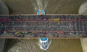2016 London Marathon runners cross Tower Bridge.