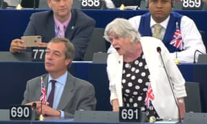"""BrexitUndated handout photo issued by EuropaTV of Brexit Party leader Nigel Farage (left) and Brexit Party MEP Ann Widdecombe giving a speech to the European Parliament in Strasborg, where she has been criticised after comparing Brexit to slaves rising up """"against their owners"""". PRESS ASSOCIATION Photo. Issue date: Thursday July 4, 2019. The former Conservative minister was making her maiden address to the parliament in Strasbourg in the wake of elections which saw a series of top EU jobs allocated behind closed doors, saying the process is """"just one of many reasons"""" why she hopes the UK leaves by the Halloween deadline. See PA story POLITICS EU. Photo credit should read: EuropaTV/PA Wire NOTE TO EDITORS: This handout photo may only be used in for editorial reporting purposes for the contemporaneous illustration of events, things or the people in the image or facts mentioned in the caption. Reuse of the picture may require further permission from the copyright holder."""