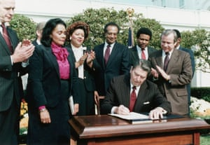 Ronald Reagan honouring King. A campaign to have King's birthday designated a federal holiday came to fruition in 1983 when Reagan signed a bill at an event attended by King's widow.