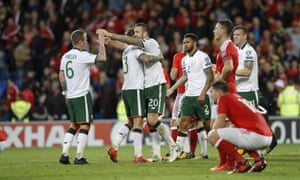 The agony and the ecstasy: Republic of Ireland players celebrate as Wales players react to their elimination at the final whistle.