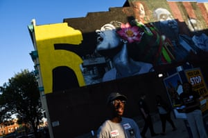 Muralist Ernest Shaw's wall featuring (left to right) Sandtown native and jazz legend Billie Holiday, Shaw's daughter, and author Ta-Nehisi Coates and his son