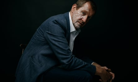Alastair Campbell with words written on his face in white