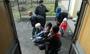 A group of migrants from Syria, Iraq and Afghanistan board a train bound for Croatia at a train station in the south of the Serbian city of Presevo, Serbia on Monday.