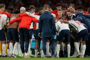 England huddle before extra time.