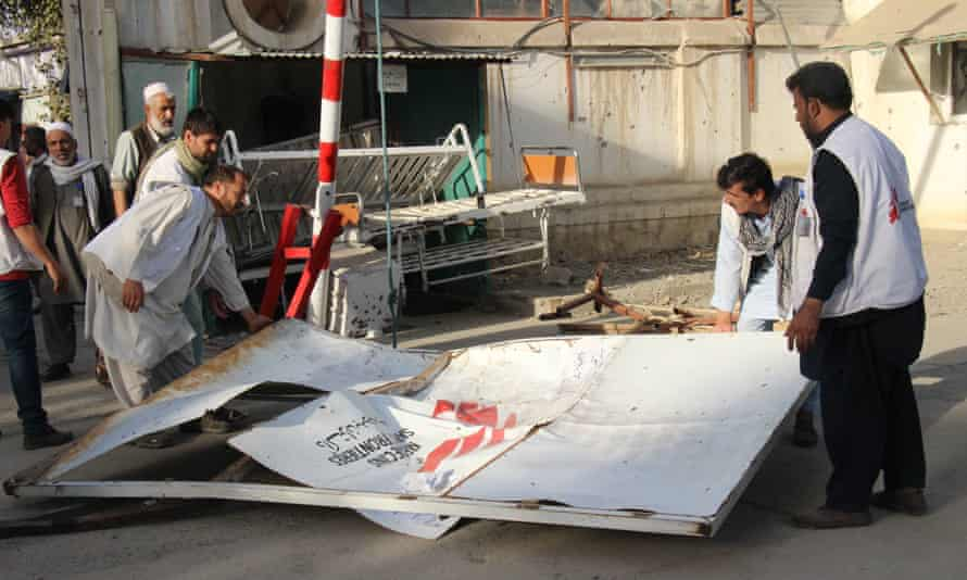 Doctors of MSF and citizens move the debris of the hospital in Kunduz damaged by the US airstrike on Thursday.