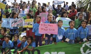 Students hold placards and shout slogans during a climate protest in Delhi, India.