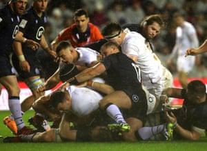 England's Ellis Genge touches down.