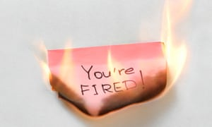 Red burning post-it note saying You're fired