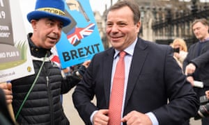 Arron Banks (right) talks to an anti-Brexit campaigner outside the Houses of Parliament.