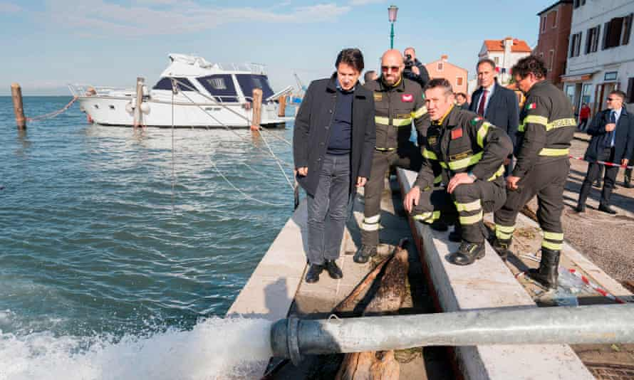 Giuseppe Conte observes a water-pumping operation