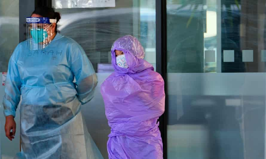 Quarantining hotel guest are moved out of the Holiday Inn near Melbourne airport on Wednesday after an outbreak of coronavirus.