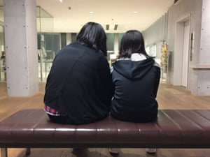 Hisako Yoshida and her daughter wait for dinner to be served at a children's cafeteria in Kawaguchi. Yoshida has struggled to provide for her three teenage children since a cancer diagnosis forced her to quit her job two years ago.
