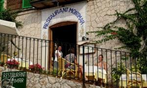 Diners sit outside Restaurant Montimar, in Montimar, Estellencs, Mallorca
