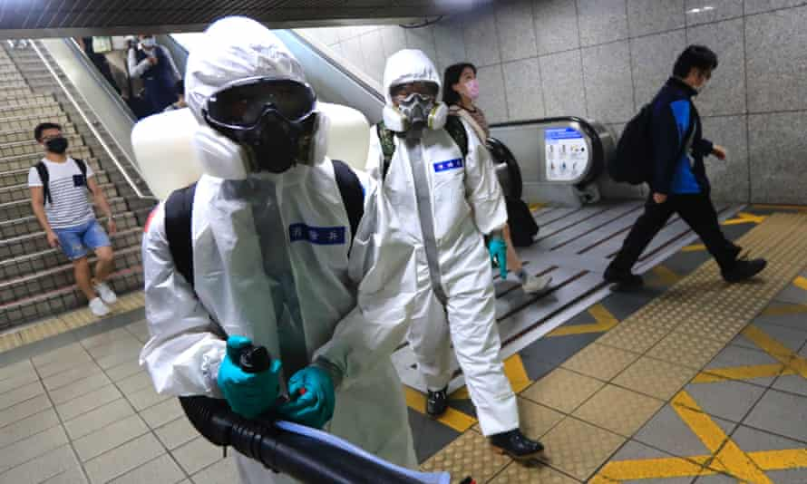 Taiwanese military officers disinfect Taipei's transport system