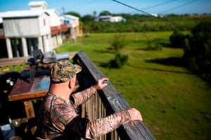 Chris Brunet sits on his porch on the island. He's one of the residents willing to be relocated.