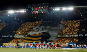 Young Boys fans display a banner as the players take to the pitch.