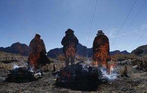 La Cumbre, Bolivia. People burn offerings in honour of 'Pachamama', or Mother Earth, on a mountain considered sacred on the outskirts of La Paz. According to lore, Pachamama awakens hungry and thirsty every August after the dry season, and to satiate her, devotees toss offerings including fruit, coca, sweets and dead llama foetuses into a bonfire