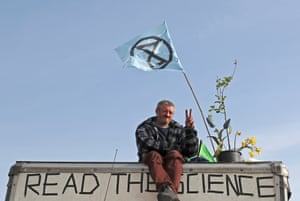 A protester sits on a vehicle blocking Waterloo Bridge